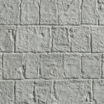 Обработанный камень серый
